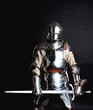 Heavy armoured man holding his sword