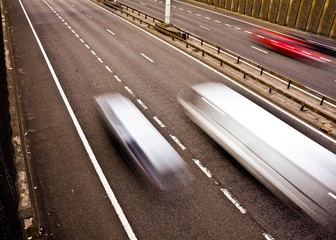 Traffic speeding along a motorway