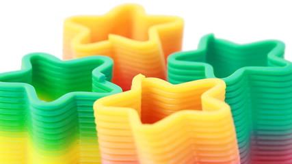 Four plastic toys-springs in form stars revolve