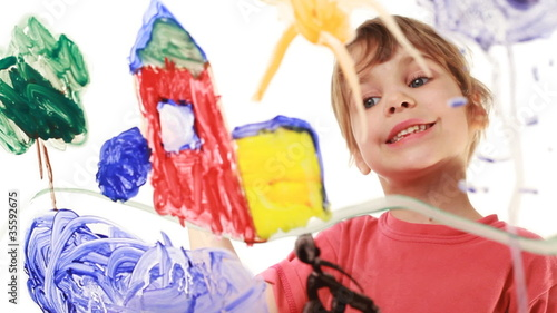 Little girl paint stairs at home in picture on glass