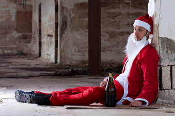 Drunken Homeless Santa Sitting on the Floor