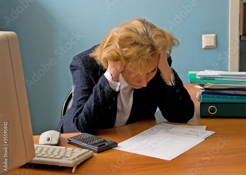Office working woman in meditation over the report
