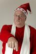 Weihnachtsmann zeigt mit Finger