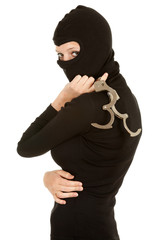 female thief in black balaclava and clothes