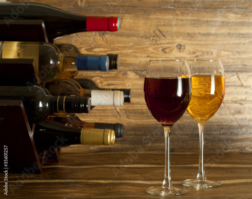 Wine rack and two glasses of wine