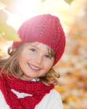 Fototapety Autumn - cute girl in autumn leaves portrait