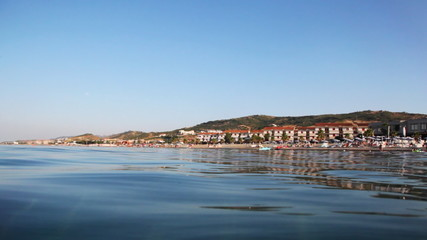 Smooth surface sea and far shore