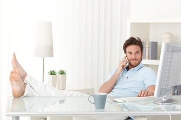 Cool man with feet up on desk