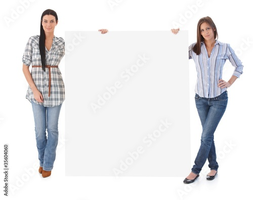Attractive women holding blank sheet