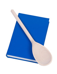 Book wit wooden spoon above.