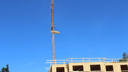 Constuction Crane Pivoting With Lumber