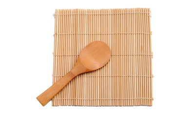 wooden spoon over bamboo placemat