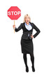 Young businesswoman holding a traffic sign stop