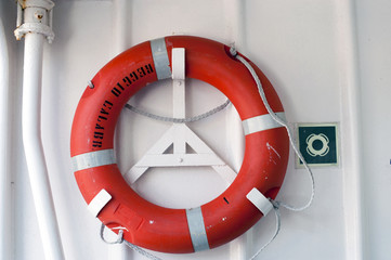 An orange lifebuoy in a gangway's ship
