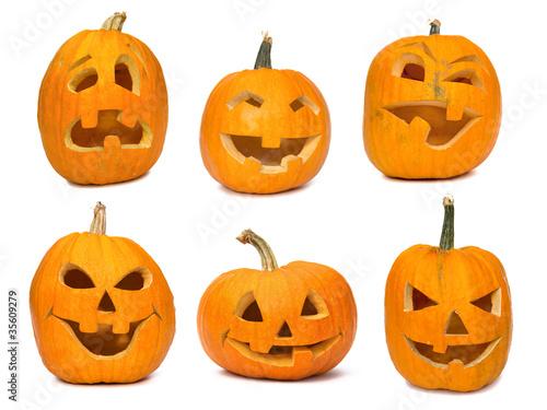 Leinwandbild Motiv Carved Jack-o-lanterns lit for Halloween. Isolated on white