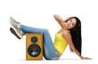 Young beautiful girl in headphones with speaker