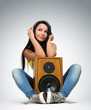 Young beautiful girl in headphones with speaker