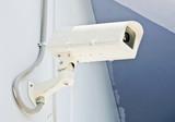 Modern white CCTV poster