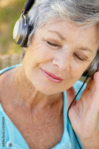 Senior woman with headphone