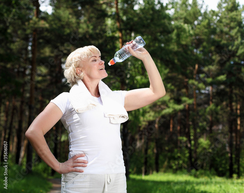 elderly woman after exercising in the forest