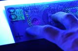 100 pln polish banknote in ultraviolet light poster