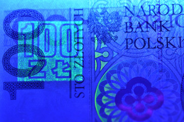 100 pln polish banknote in ultraviolet light