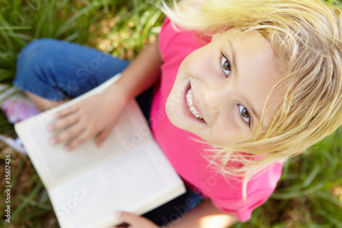 Portrait of happy girl with book