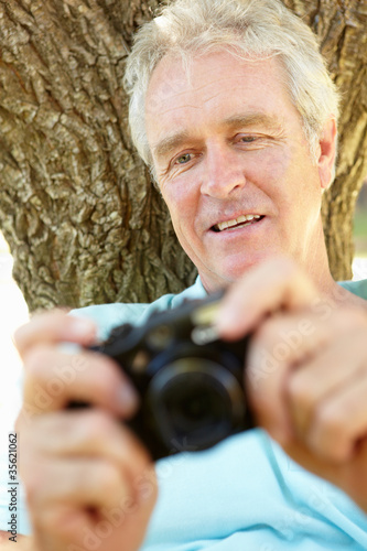 Senior man with camera