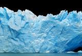 Blue icebergs isolated on black.
