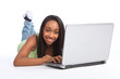 Cute African teenager girl using laptop