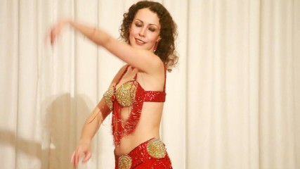 Belly dancer in red dress perform at stage