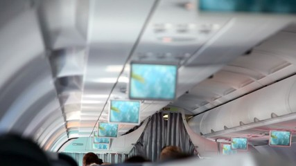 Aircraft cabin, under ceiling hung displays