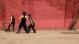 Dance team of girls start dance synchronously, then fall down