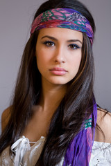 Beautiful young woman with bandana