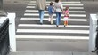 Family stand at edge of pedestrian crossing road