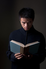 Chinese Man Reading Book
