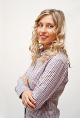 Blond woman in checked shirt