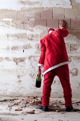 Staggering Drunken Santa Holding on a Wall