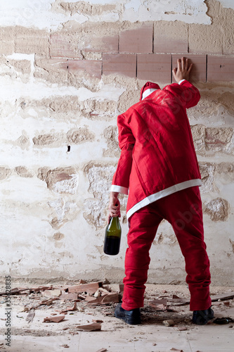 Staggering Drunken Santa Holding on a Wall - 35628835