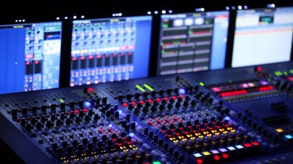 Modern mixer panel is during a concert