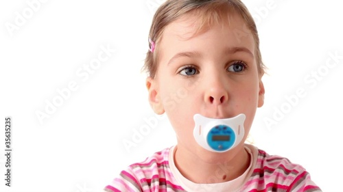 Girl holds thermometer in form nipples in mouth