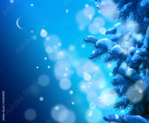Christmas tree on  blue night sky background