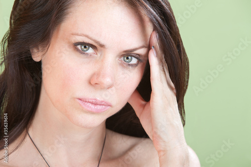 Upset Woman Holds Head