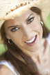 Outdoor Portrait of Beautiful Young Woman In Straw Cowboy Hat