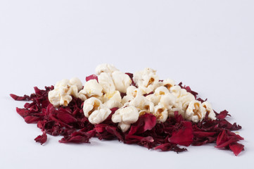 Popcorn on a pile of petals