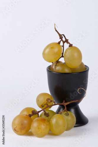 A bunch of grapes in a small cup #4