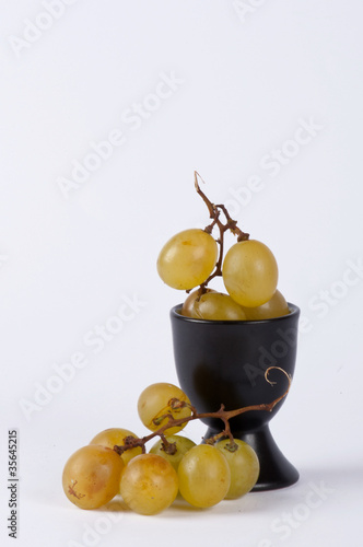 A bunch of grapes in a small cup #3