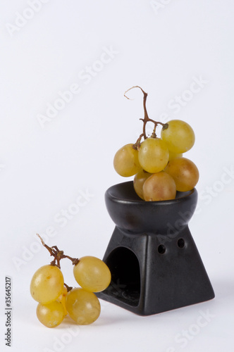 A bunch of grapes in a small cup #2
