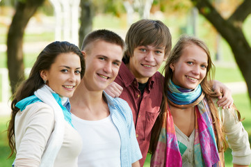 Group of smiling young students outdoors