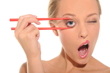 Surprised woman opens her eyes chopsticks